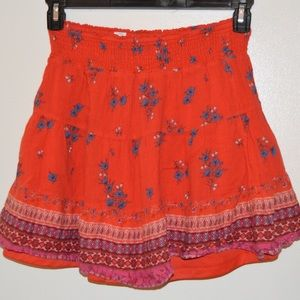 Double layer red skirt with details